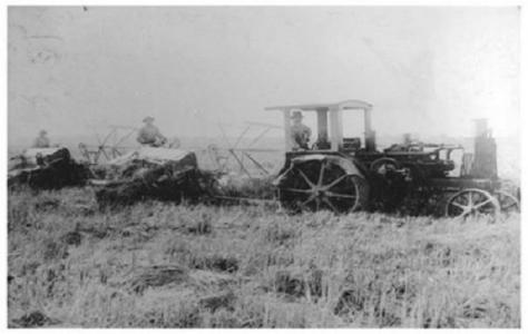 Kichimatsu Kishi in the rice fields with laborers